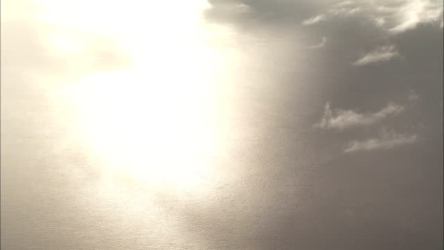 Sunlight reflects off the Amazon River. Available in HD.