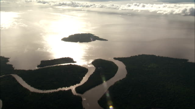 Sunlight reflects off the Amazon River delta. Available in HD.