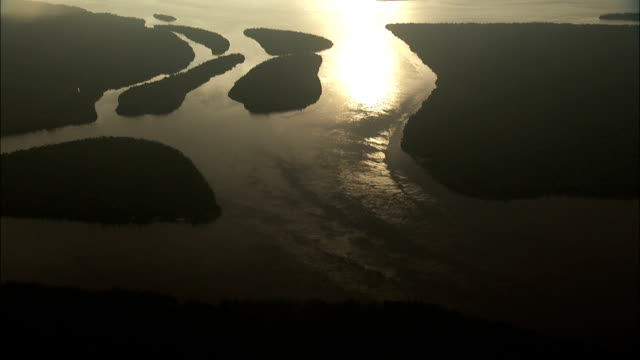 Sunlight reflects off the Amazon River delta where it meets the sea. Available in HD.