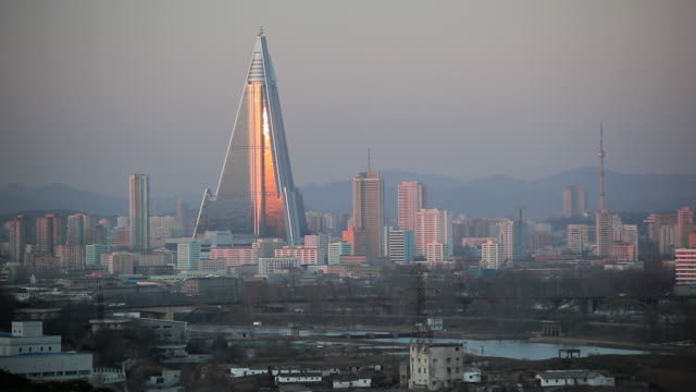 sunlight reflects off the ryugyong hotel in the city of pyongyang, north korea. - north korea stock videos & royalty-free footage