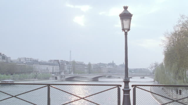 sunlight reflects off the seine river. - railings stock videos & royalty-free footage