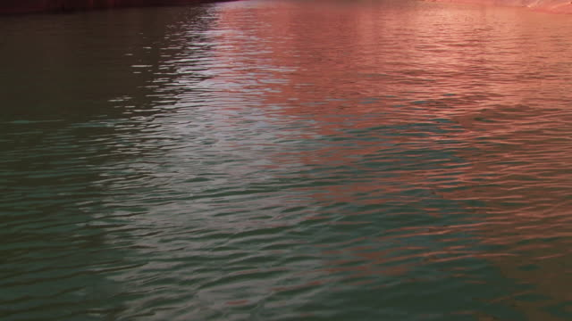 sunlight reflects on the rippling surface of lake powell. - lago powell video stock e b–roll