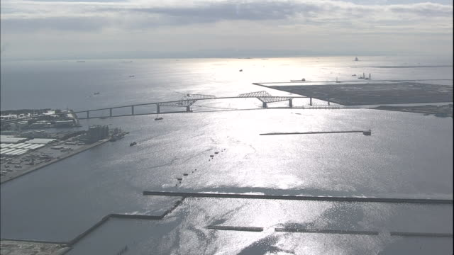 sunlight reflects on tokyo bay in the tokyo gate bridge area. - ariake sea stock videos and b-roll footage