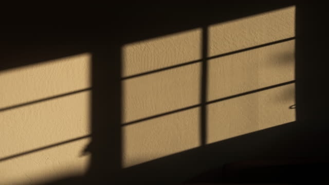 sunlight shades motion on the wall 4k dci - shade stock videos & royalty-free footage