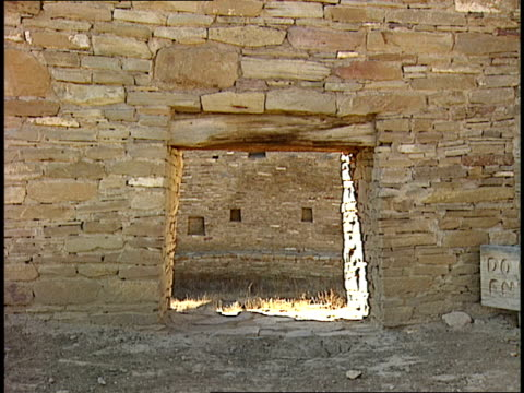 sunlight shines through doorways of the casa rinconada in chaco canyon, new mexico. - chaco canyon stock videos & royalty-free footage