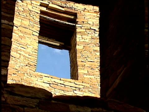 sunlight shines through the interior stone walls of pueblo bonito. - pueblo bonito stock videos & royalty-free footage