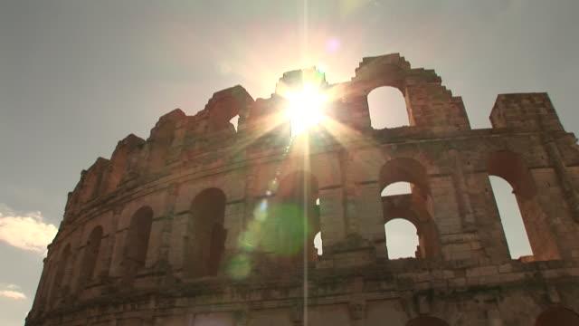 stockvideo's en b-roll-footage met sunlight shines through the roman ruins at el djem. - el djem