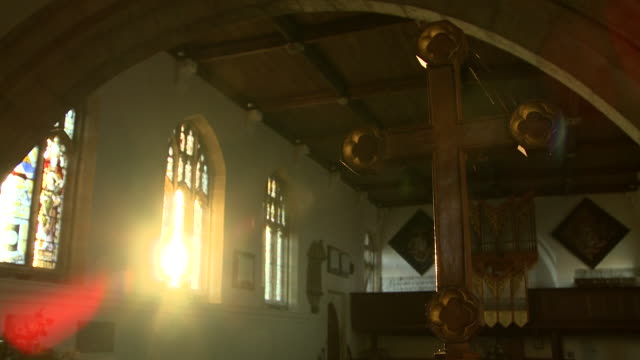 vídeos y material grabado en eventos de stock de sunlight shines through the stained glass windows of a church.  - vidriera de colores