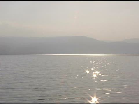 sunlight shining on the sea of galilee - historical palestine stock videos & royalty-free footage