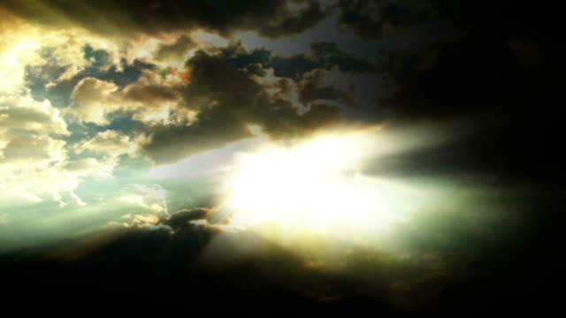 sunlight shoots though roiling clouds in a stormy sky. - digital enhancement stock videos & royalty-free footage