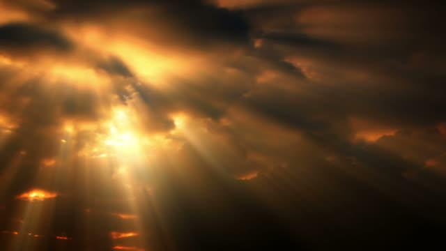 Sunlight streaks down through time lapse clouds (Loop).
