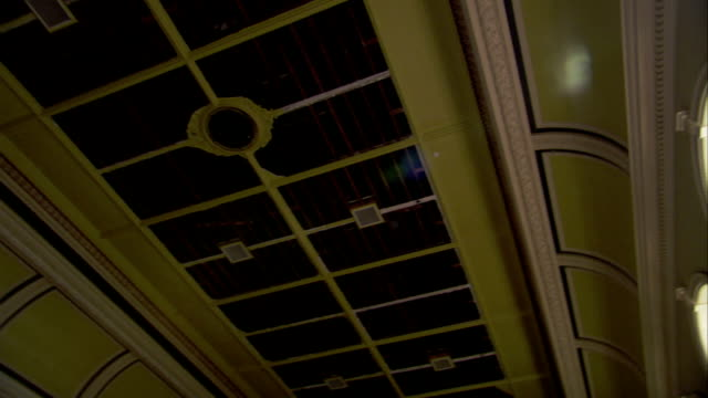 sunlight streams through arched windows onto the floor of a large hall at high royds former psychiatric hospital. available in hd. - ray stock videos and b-roll footage