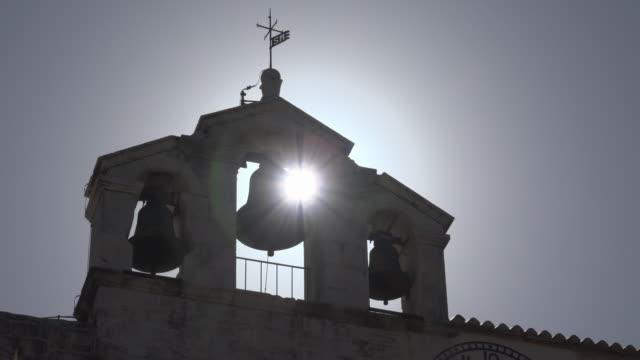 vídeos y material grabado en eventos de stock de sunlight through bells of fortress church of st. mary of mercy - cultura croata