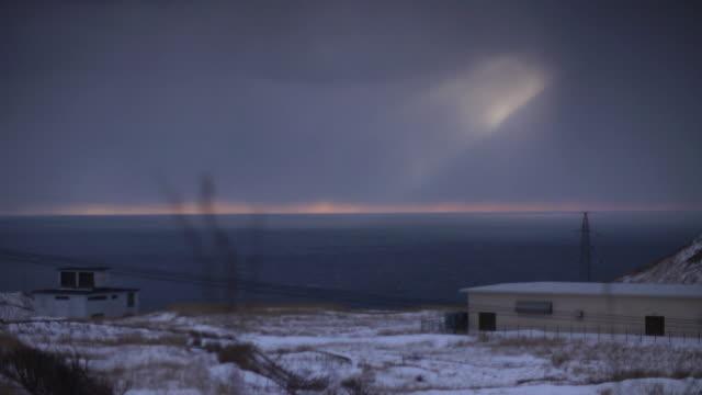 sunlight through clouds into sea, aomori, japan - winter点の映像素材/bロール