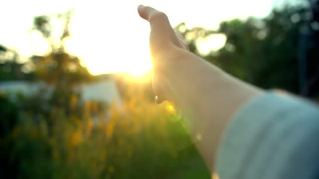 sunlight through human hand - light beam stock videos & royalty-free footage