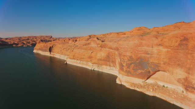 aerial sunlit cliffs at lake powell, usa - lake powell stock videos & royalty-free footage