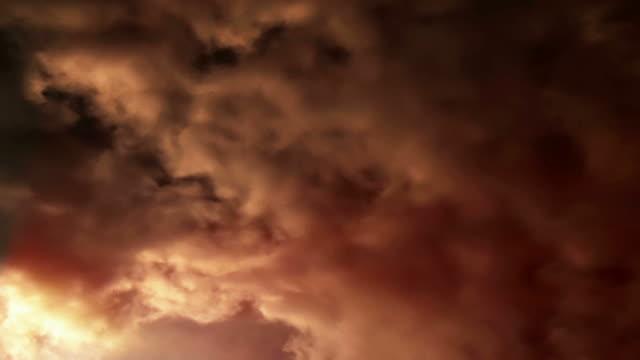 Sunlit clouds roil across the sky (Loop).