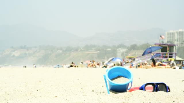 stockvideo's en b-roll-footage met sunny afternoon on the beach - badmeester