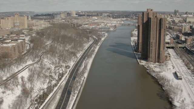 sunny day aerial view of harlem river through washington heights and morris heights - university of washington stock videos & royalty-free footage