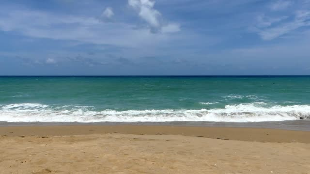 sunny day at mai khao beach, phuket international airport - horizon over water stock videos & royalty-free footage