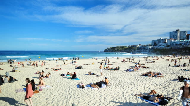 sunny day in bondi beach time lapse - sydney australia stock videos and b-roll footage