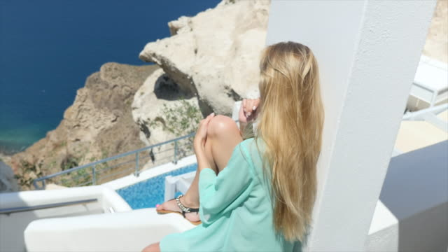 sunny day in santorini & cute woman - santorini stock videos and b-roll footage