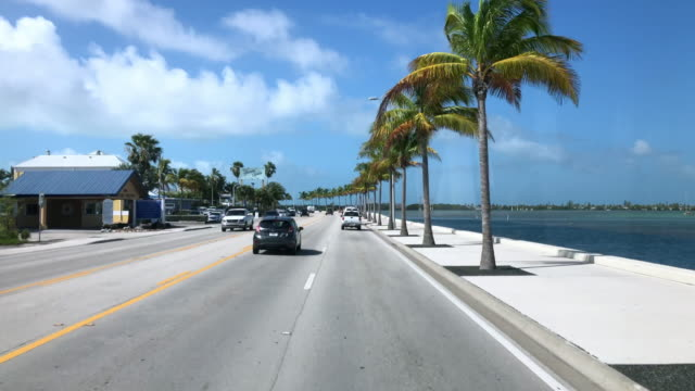 sunny day of dashboard camera point of view of highway driving in florida - key west stock videos & royalty-free footage