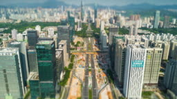 sunny day shenzhen cityscape downtown traffic street construction aerial panorama 4k tilt shift timelapse china