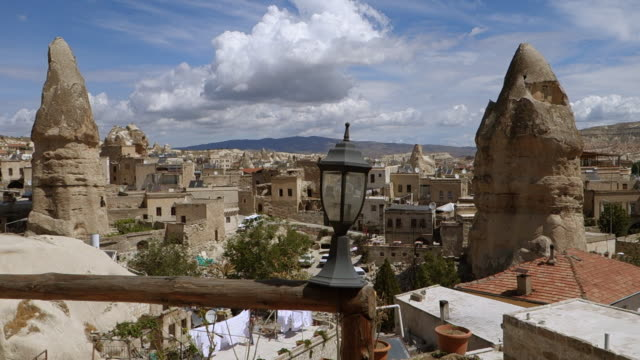 sunny day view of cave homes - cappadocia, turkey - cappadocia stock videos and b-roll footage