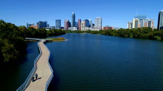 sunny days in austin texas above walking bridge - pedestrian walkway stock videos & royalty-free footage