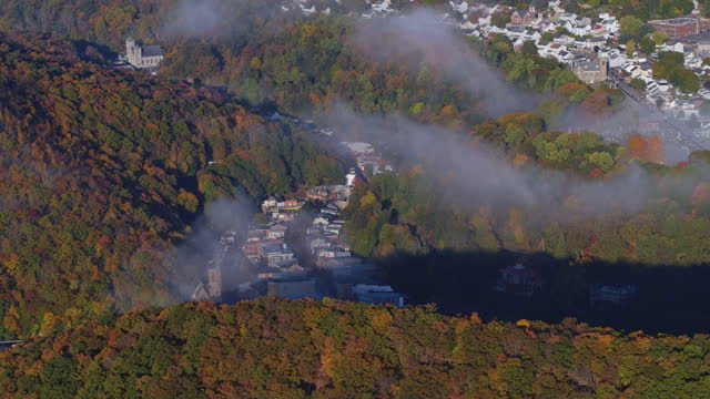 sunny early morning in the pocono mountains with low clouds over the historical downtown of jim thorpe town, pennsylvania, carbon county. aerial video with the forward and tilting-down camera motion. - street name sign stock videos & royalty-free footage