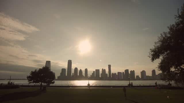 sunny imagery of silhouetted people by the hudson river with jersey city with the sun setting in the background on august 16, 2021 in new york city,... - atmosphere filter stock videos & royalty-free footage