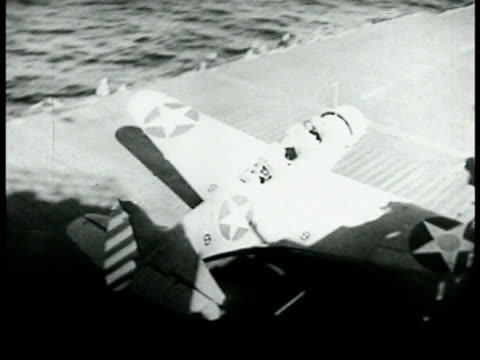 douglas tbd1 'devastator' torpedo bomber taxiing on carrier flight deck vs airplanes taking off from us aircraft carrier world war ii - pacific war stock videos and b-roll footage