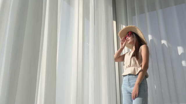 sunny summer portrait of beautiful young woman near the window - directly below stock videos & royalty-free footage