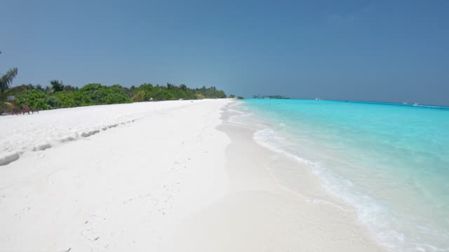 ms sunny tropical ocean beach,maldives - panning stock videos & royalty-free footage