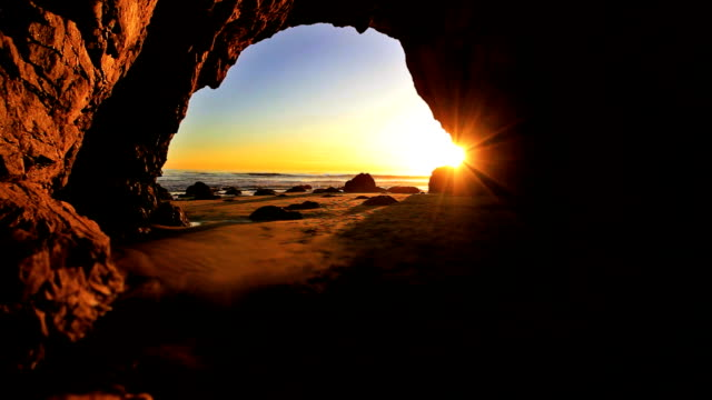 sunrays in beach cave - cave stock videos & royalty-free footage
