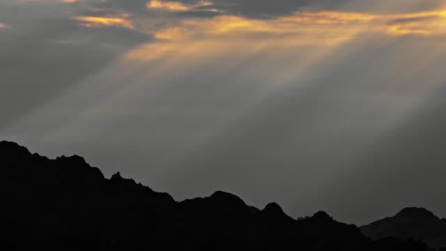 Sunrays over the mountain peak
