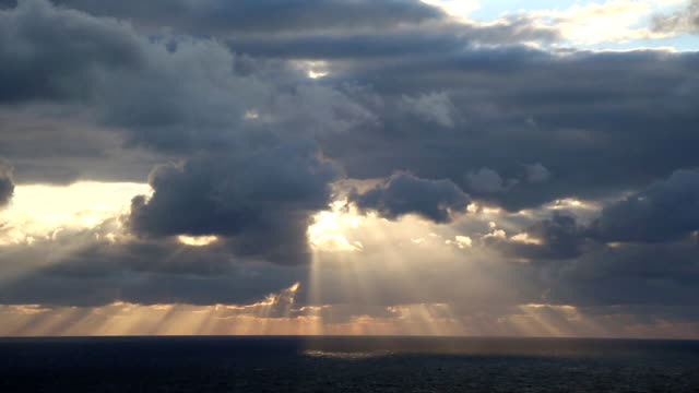 sunrays through the clouds (timelapse) - dramatic sky stock videos and b-roll footage