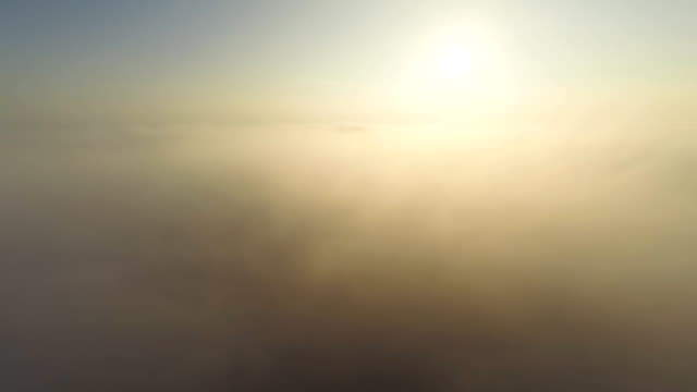aerial sunrise above the fog - multicopter stock videos & royalty-free footage