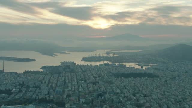 sunrise aerial athens, greece, over city out to coast - athens greece stock videos & royalty-free footage