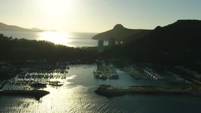 sunrise aerial over hamilton island marina barrier reef - anchored stock videos & royalty-free footage
