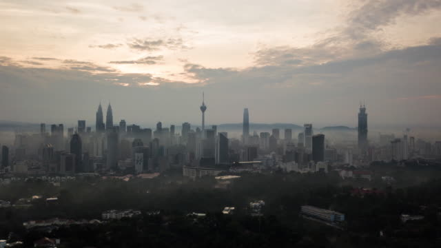 sunrise aerial time lapse at kuala lumpur city centre - malaysia stock videos & royalty-free footage