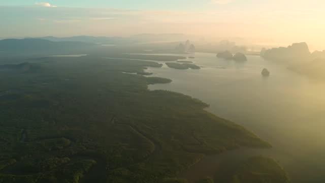 soluppgång flygfoto över phang nga bay med höga berg - andamansjön bildbanksvideor och videomaterial från bakom kulisserna