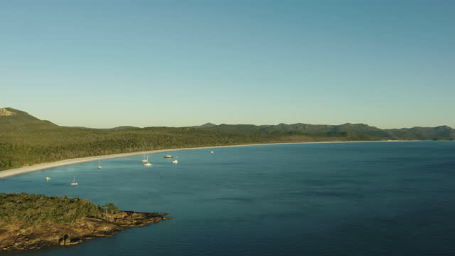 sunrise aerial whitehaven beach whitsunday island barrier reef - anchored stock videos & royalty-free footage