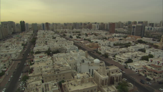 vídeos de stock, filmes e b-roll de sunrise, ahbu dabi, sunrise to morning from sands hotel, abu dhabi, united arab emirates  - 2012