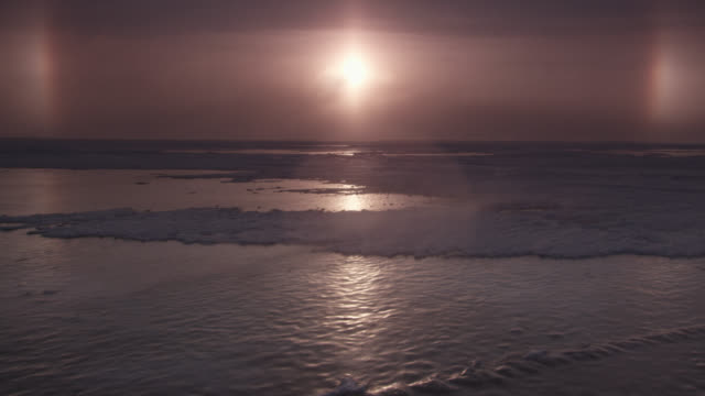 sunrise and ice halo over coast, canada - manitoba stock videos & royalty-free footage