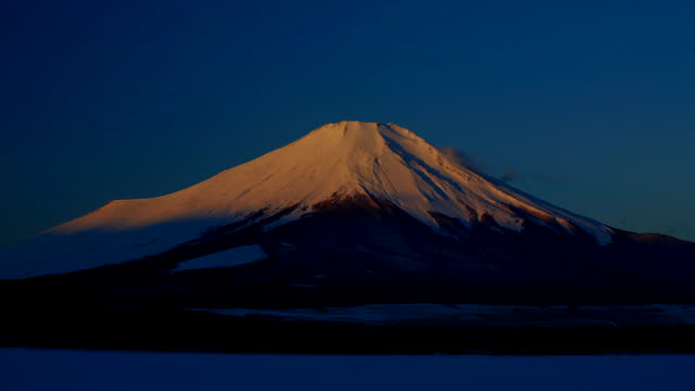 t/l, ms, sunrise and shadows revealing mount fuji / shizuoka prefecture, japan - mt fuji stock videos & royalty-free footage