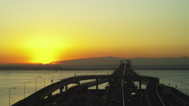 sunrise and umihotaru in japan - tokyo bay stock videos and b-roll footage