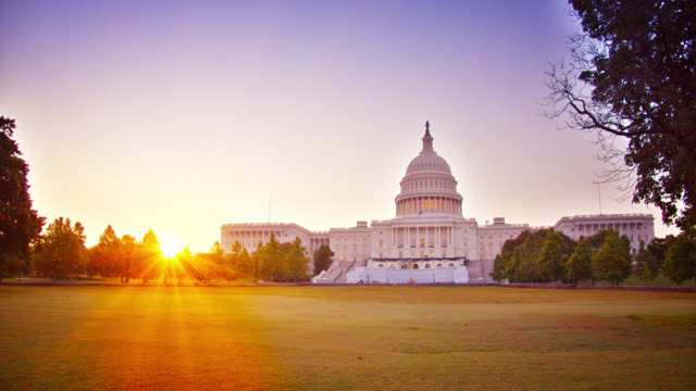 sunrise and united states capitol - federal building stock videos & royalty-free footage