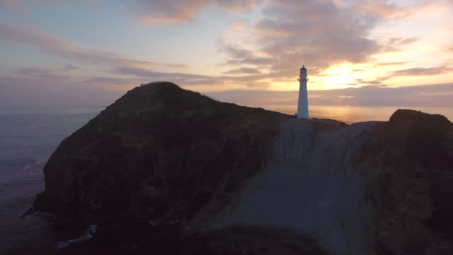sunrise at castlepoint lighthouse. - lighthouse stock videos & royalty-free footage